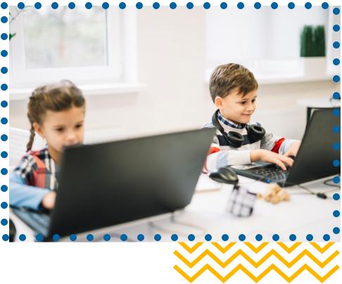 Children learning whilst using laptops